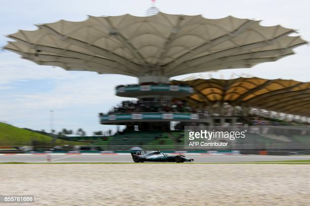 Mercedes's Finnish driver Valtteri Bottas drives his car during the third practice session of the Formula One Malaysia Grand Prix in Sepang on...
