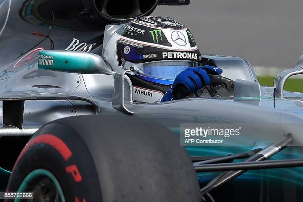 Mercedes's Finnish driver Valtteri Bottas powers his car during the third practice session of the Formula One Malaysia Grand Prix in Sepang on...
