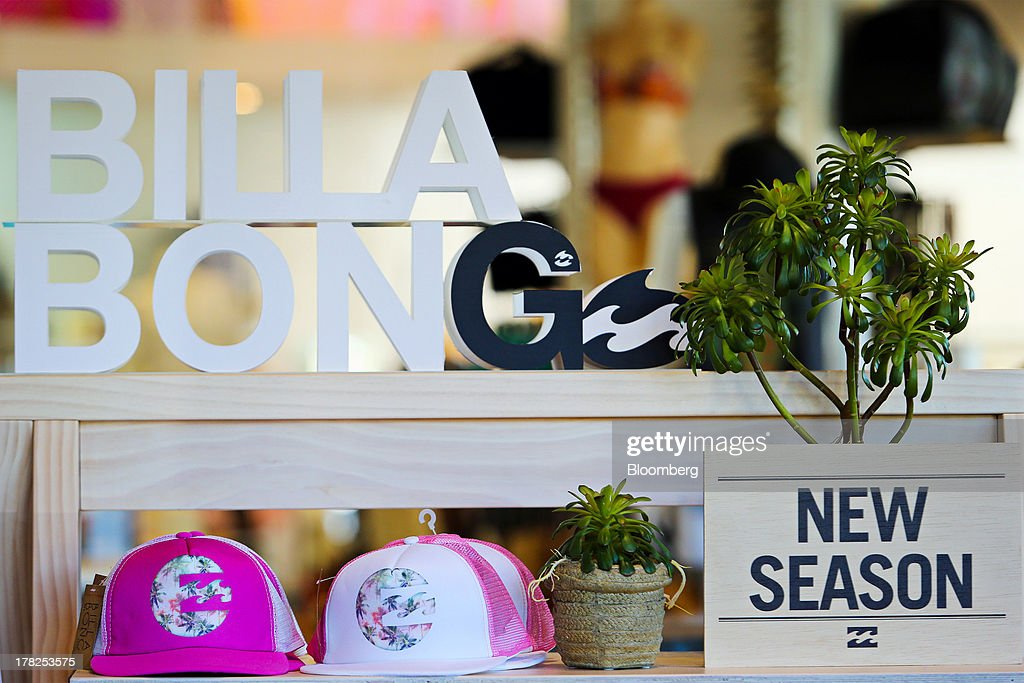 Merchandise and signage sit on display inside a Billabong International Ltd. retail store at the company's headquarters in Burleigh Heads, Australia, on Wednesday, Aug. 28, 2013. Billabong, the surf brand founded in 1973, helped sell Australian surfing culture worldwide and rose to a market value of A$3.84 billion ($3.45 billion) at its peak in 2007 said its 40-year-old surf brand was worthless after the companys losses tripled amid store closures, firings and a breach of debt terms. Photographer: Patrick Hamilton/Bloomberg via Getty Images