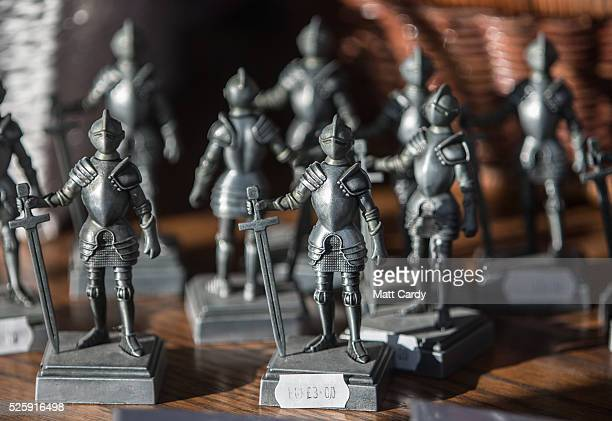 Merchandise inspired by the legend of King Arthur is displayed in the window of a shop in Tintagel on April 27 2016 in Cornwall England The English...
