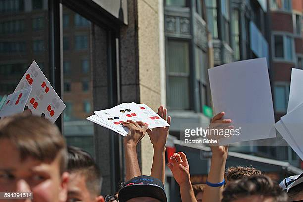 Merchandise menu cards are passed out in the crowd to make selection time faster as a popup store selling clothing linked to Kanye West's album The...