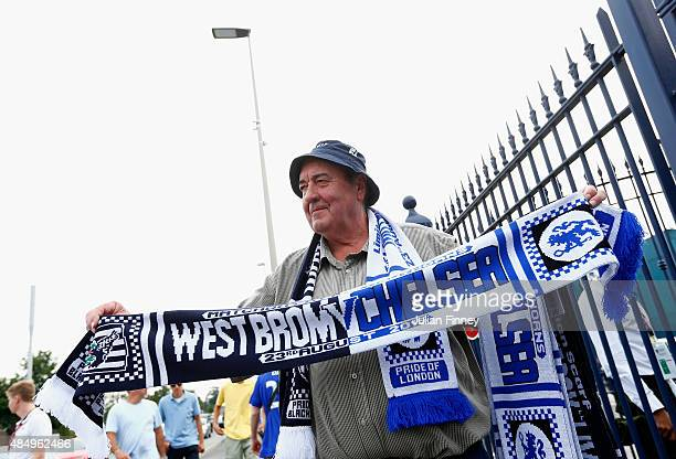 A merchandise seller holds the match scarf prior to the Barclays Premier League match between West Bromwich Albion and Chelsea at The Hawthorns on...