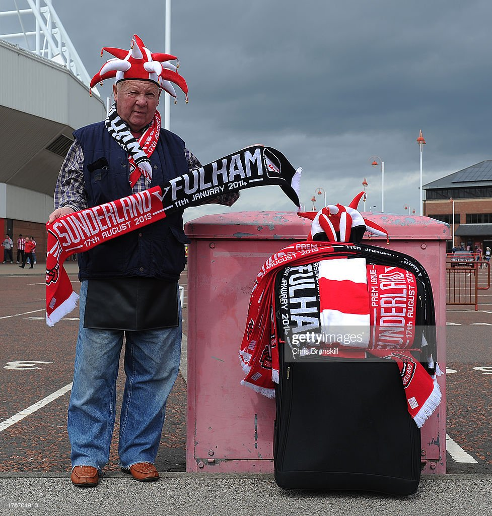 A merchandise seller poses ahead of the Barclays Premier League match between Sunderland and Fulham at the Stadium of Light on August 17, 2013 in Sunderland, England.