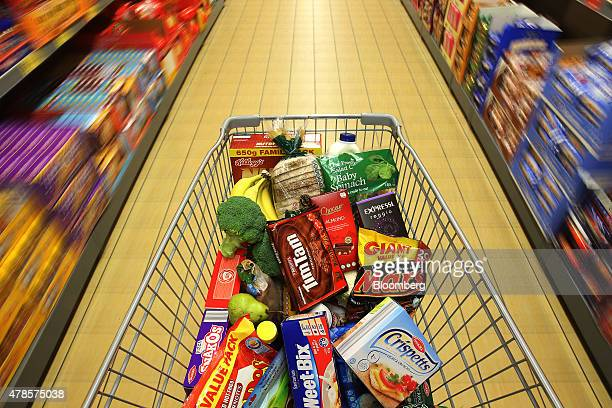 Merchandise sit inside a shopping cart at an Aldi Stores Ltd food store in Sydney Australia on Thursday June 25 2015 Australia's biggest supermarkets...