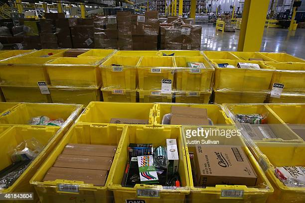 Merchandise sits in containers at an Amazon fulfillment center on January 20 2015 in Tracy California Amazon officially opened its new 12 million...