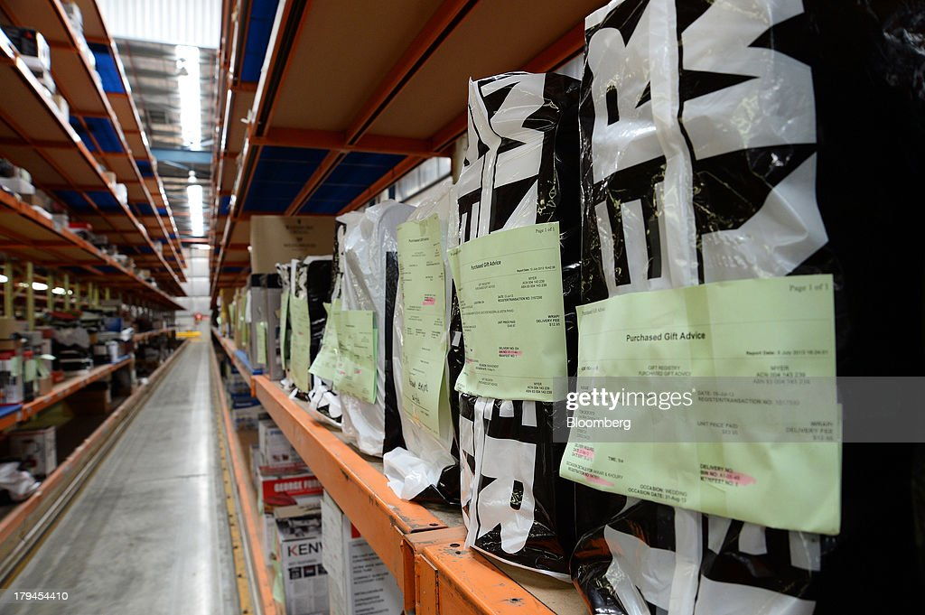 Merchandise wrapped in branded bags sit on a shelf as they await distribution at the Myer Holdings Ltd. distribution center in Melbourne, Australia, on Tuesday, Sept. 3, 2013. A Bureau of Statistics report released in Sydney on Sept. 4 showed household spending climbed 0.4 percent in the second quarter, adding 0.2 percentage point to gross domestic product growth. Photographer: Carla Gottgens/Bloomberg via Getty Images