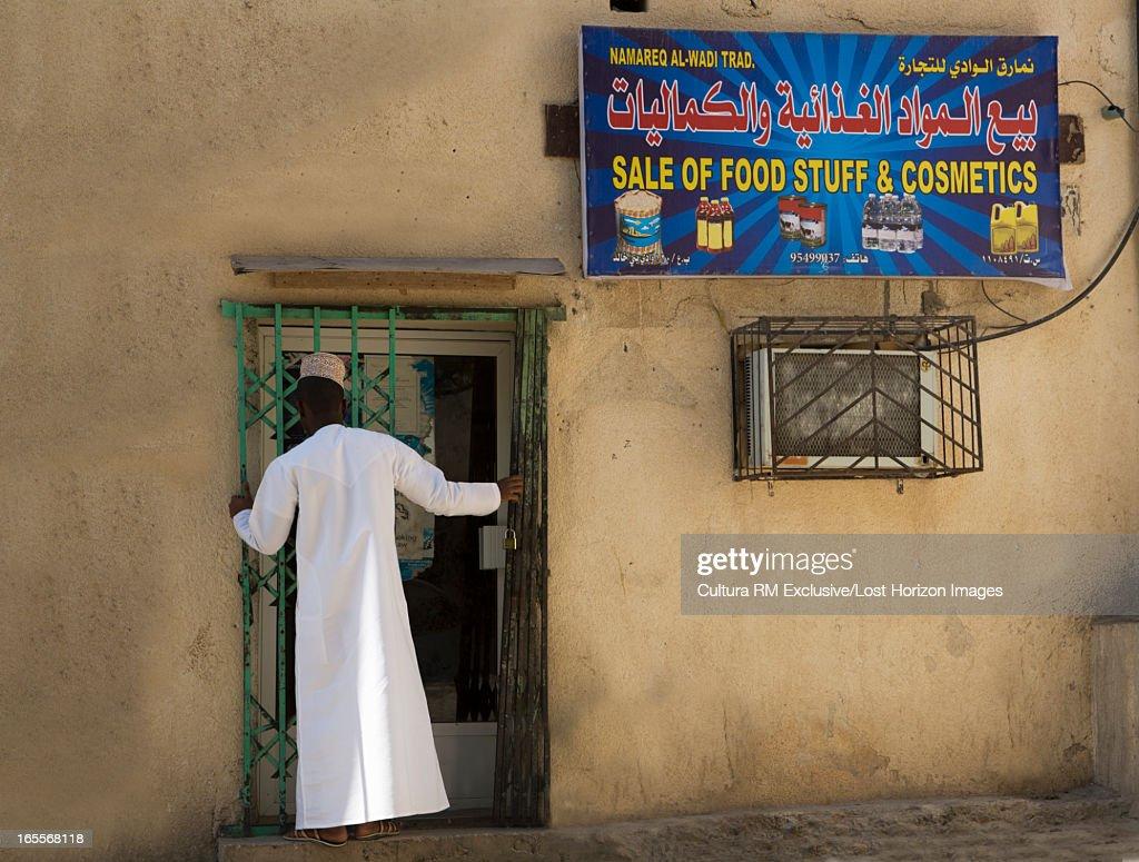 Merchant opening his store : Stock Photo
