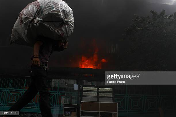 Merchant trying to save his belongings during a fire in the building of the shopping center Pasar Senen Jakarta The fire was reported at 445 am and...