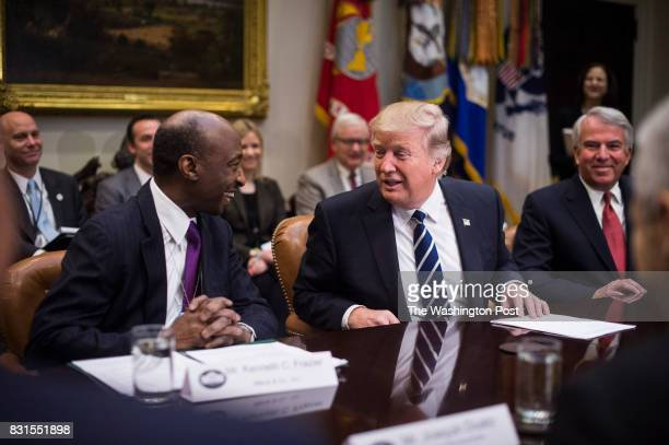 Merck Chairman and CEO Ken Frazier left talks to President Trump during a meeting with pharmaceutical industry leaders in the Roosevelt Room of the...