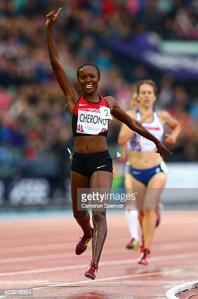 Mercy Cherono of Kenya crosses the line to win gold in the Women's 5000 metres final at Hampden Park during day ten of the Glasgow 2014 Commonwealth...