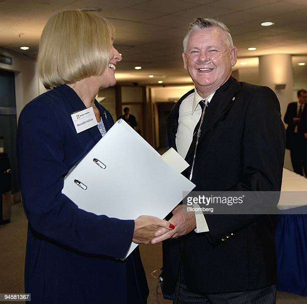 Meredith Hellicar chairwoman of James Hardie Industries NV left is greeted by Bernie Banton asbestos victim and compensation campaigner following the...