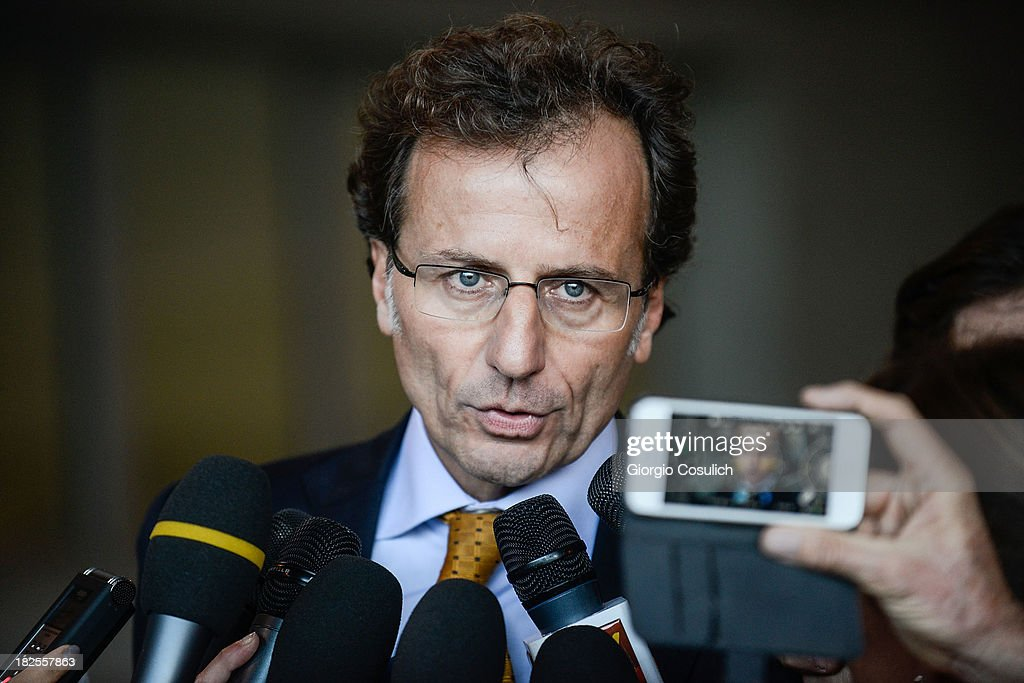 Meredith Kercher's family lawyer, Francesco Maresca, talks to the media at the new Courthouse at the end of the appeal trial of Amanda Knox and Raffaele Sollecito on September 30, 2013 in Florence, Italy. Both Knox and Sollecito had their convictions overturned and were released in 2011 after four years in prison. Knox has no plans to return to Italy for their retrial and will be represented by her laywers in court.