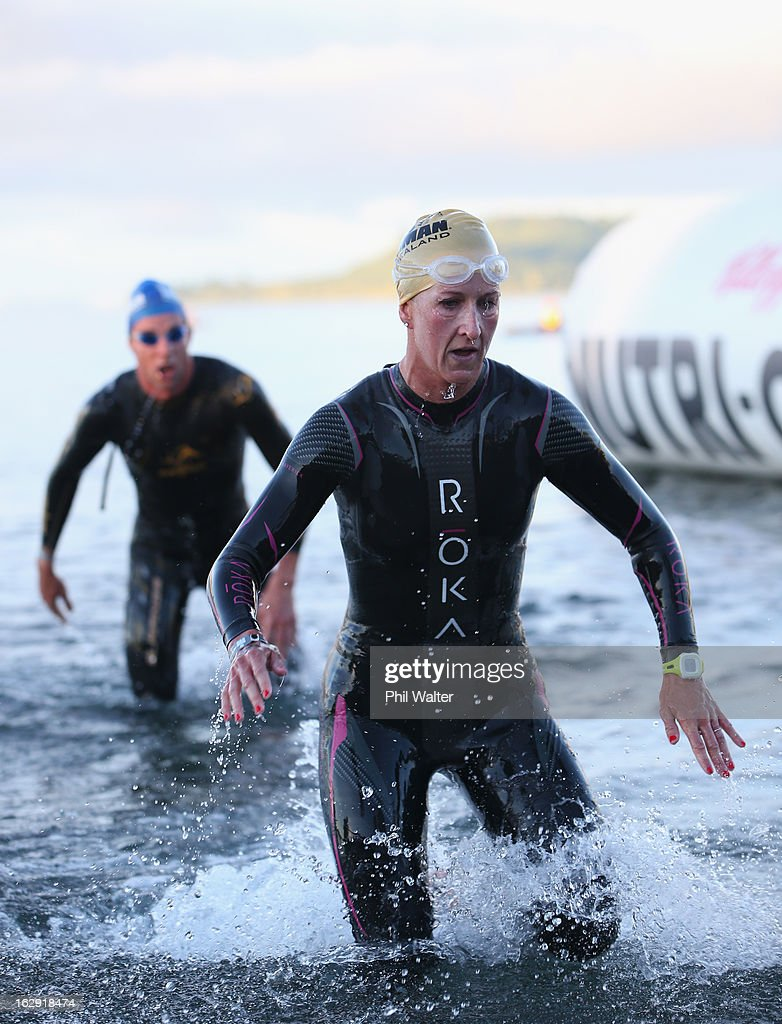 Meredith Kessler of the USA leaves the water after the swim leg during the New Zealand Ironman on March 2, 2013 in Taupo, New Zealand.