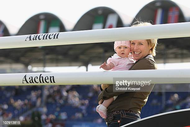 Meredith MichaelsBeerbaum and her daughter Brianne smile before the MercedesBenz Prize as part of the Meydan FEI Nations Cup of the CHIO on July 15...
