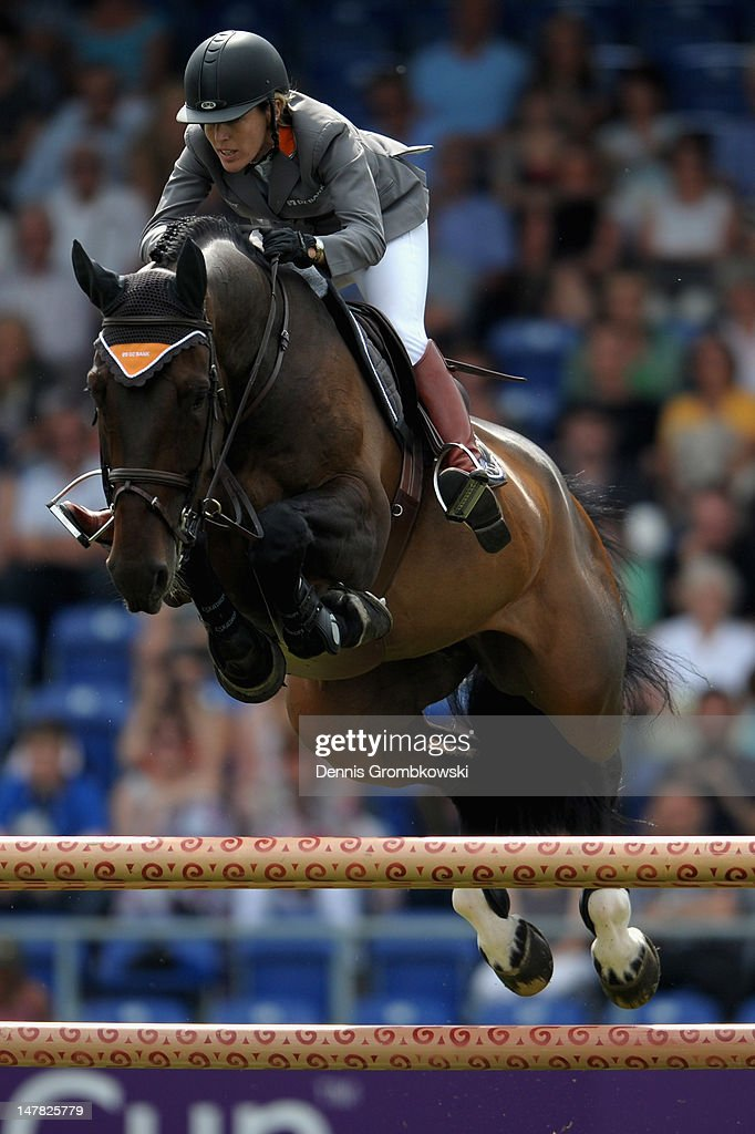 <a gi-track='captionPersonalityLinkClicked' href=/galleries/search?phrase=Meredith+Michaels-Beerbaum&family=editorial&specificpeople=224890 ng-click='$event.stopPropagation()'>Meredith Michaels-Beerbaum</a> of Germany and Bella Donna compete in the Warsteiner Price of Europe S4 jumping competition during day two of the 2012 CHIO Aachen tournament on July 4, 2012 in Aachen, Germany.
