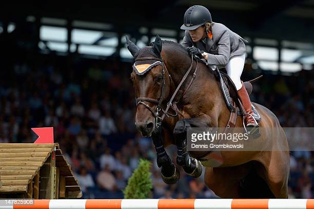 Meredith MichaelsBeerbaum of Germany and Bella Donna compete in the Warsteiner Price of Europe S4 jumping competition during day two of the 2012 CHIO...