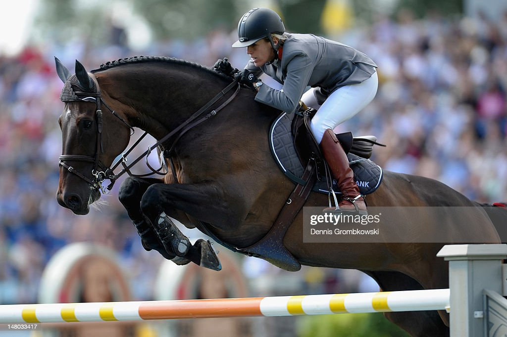 <a gi-track='captionPersonalityLinkClicked' href=/galleries/search?phrase=Meredith+Michaels-Beerbaum&family=editorial&specificpeople=224890 ng-click='$event.stopPropagation()'>Meredith Michaels-Beerbaum</a> of Germany and her horse Bella Donna 66 compete in the Rolex Grand Prix jumping competition during day six of the 2012 CHIO Aachen tournament on July 8, 2012 in Aachen, Germany.