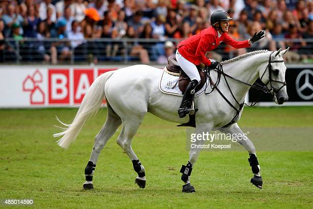 Meredith MichaelsBeerbaum of Germany celebrates after doing a good ride with her horse Fibonacci during the Rolex European Champion jumping...
