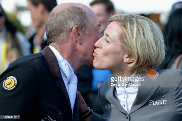 Meredith MichaelsBeerbaum of Germany congratulates Michael Whitaker of Great Britain after Rolex Grand Prix jumping competition during day six of the...