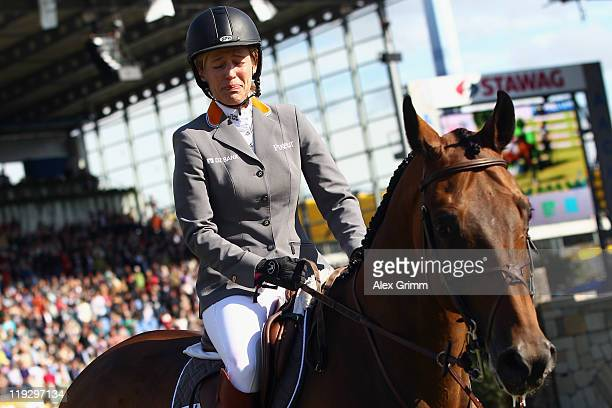 Meredith MichaelsBeerbaum of Germany cries during a farewell ceremony for her horse Shutterfly at the CHIO on July 17 2011 in Aachen Germany