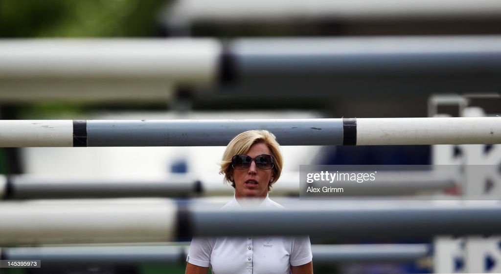 <a gi-track='captionPersonalityLinkClicked' href=/galleries/search?phrase=Meredith+Michaels-Beerbaum&family=editorial&specificpeople=224890 ng-click='$event.stopPropagation()'>Meredith Michaels-Beerbaum</a> of Germany looks on prior to the CSI jumping 'Preis der Landeshauptstadt Wiesbaden' competition at the 76th international horse show at whitsun on May 28, 2012 in Wiesbaden, Germany.