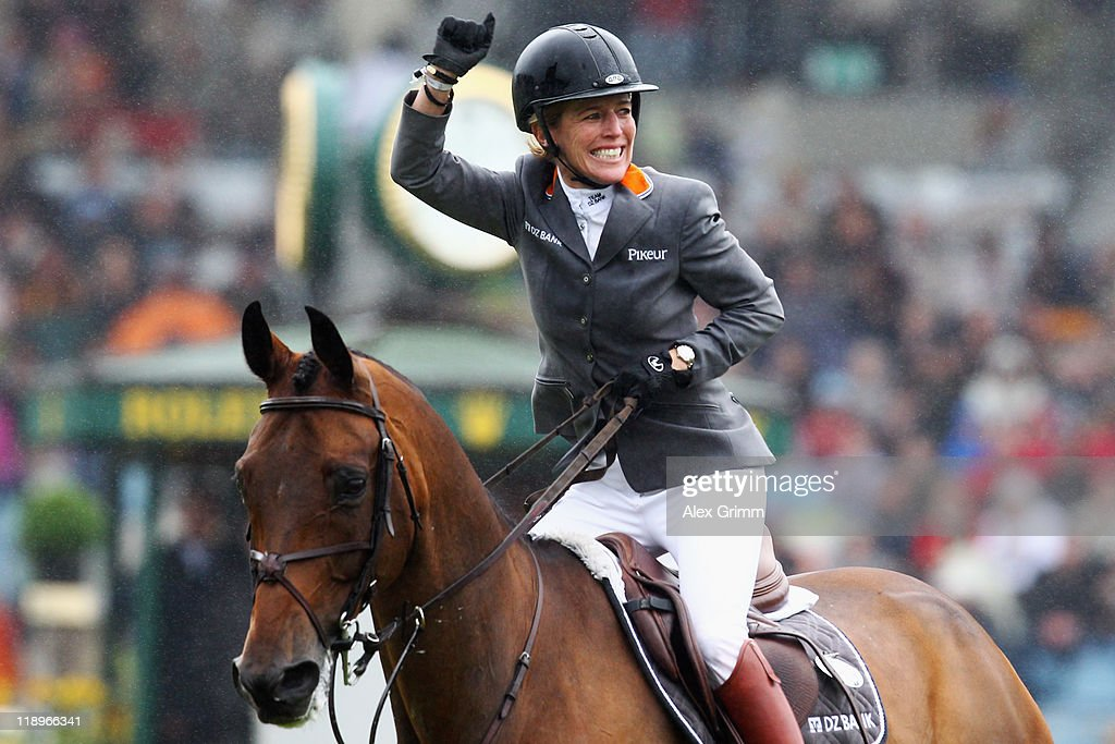 <a gi-track='captionPersonalityLinkClicked' href=/galleries/search?phrase=Meredith+Michaels-Beerbaum&family=editorial&specificpeople=224890 ng-click='$event.stopPropagation()'>Meredith Michaels-Beerbaum</a> of Germany on her horse Shutterfly celebrates after winning the Warsteiner jumping competition at the CHIO on July 13, 2011 in Aachen, Germany.