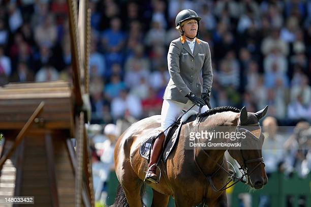 Meredith MichaelsBeerbaum of Germany reacts on her horse Bella Donna 66 after competing in the Rolex Grand Prix jumping competition during day six of...