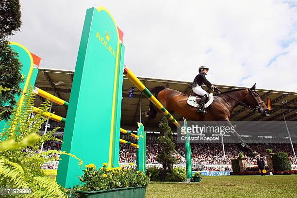 Meredith MichaelsBeerbaum of Germany rides on Bella Donna during the Rolex Grand Prix jumping competition during the 2013 CHIO Aachen tournament on...