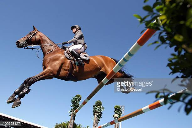 Meredith MichaelsBeerbaum of Germany rides on Shutterfly during the Rolex Grand Prix Jumping competition of the CHIO on July 18 2010 in Aachen Germany