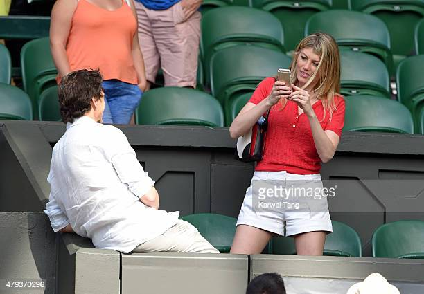 Meredith Ostrom and Lawrence Bender attend the Novak Djokovic v Bernard Tomic match on day five of the annual Wimbledon Tennis Championships at...