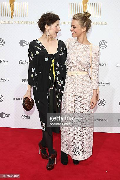 Meret Becker and Heike Makatsch arrive for the Lola German Film Award 2013 at FriedrichstadtPalast on April 26 2013 in Berlin Germany