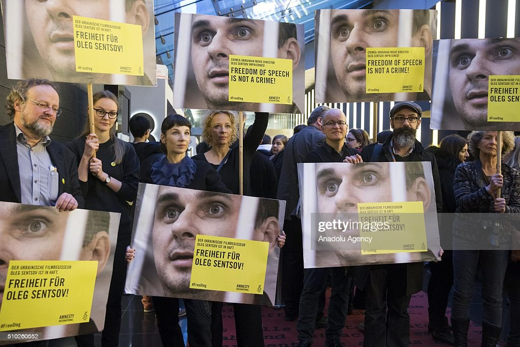 Meret Becker (3rd L) and Katja Rieman (4th L) take part in a protest for the release of Ukrainian director Oleg Sentsov during the 66th annual Berlin International Film Festival, in Berlin, Germany, 14 February 2016.