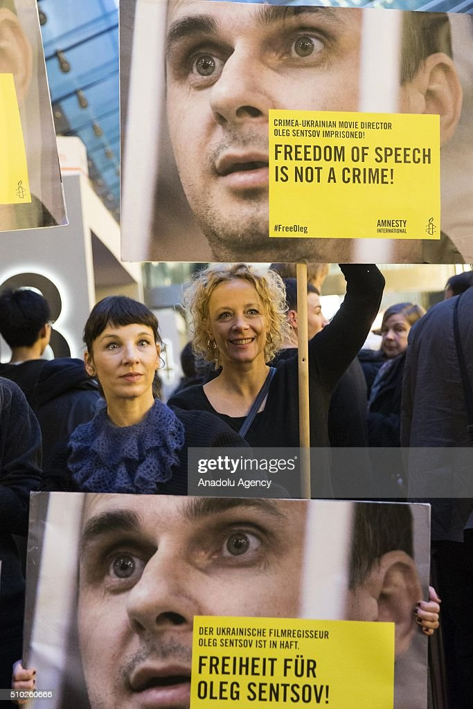 Meret Becker (L) and Katja Rieman (R) take part in a protest for the release of Ukrainian director Oleg Sentsov during the 66th annual Berlin International Film Festival, in Berlin, Germany, 14 February 2016.