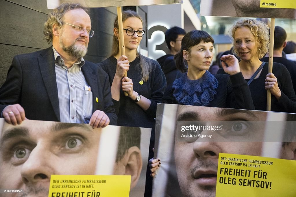 Meret Becker (2nd R) and Katja Rieman (R) take part in a protest for the release of Ukrainian director Oleg Sentsov during the 66th annual Berlin International Film Festival, in Berlin, Germany, 14 February 2016.