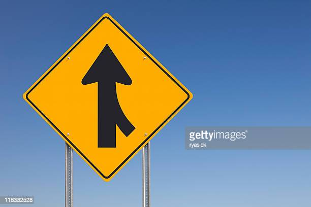 Merge Ahead Traffic Sign Post over Clear Blue Sky Background