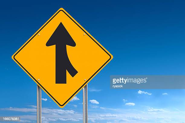Merge Converge Ahead Road Sign Post Over Blue Sky Background