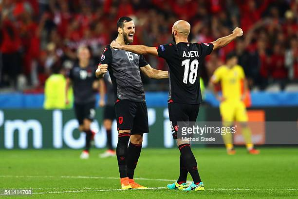 Mergim Mavraj and Arlind Ajeti of Albania celebrate their 10 win in the UEFA EURO 2016 Group A match between Romania and Albania at Stade des...