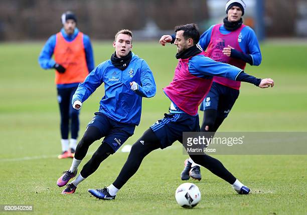 Mergim Mavraj battles for the ball with Gian Luca Waldschmidt during a training session of Hamburger SV at Volksparkstadion on January 4 2017 in...