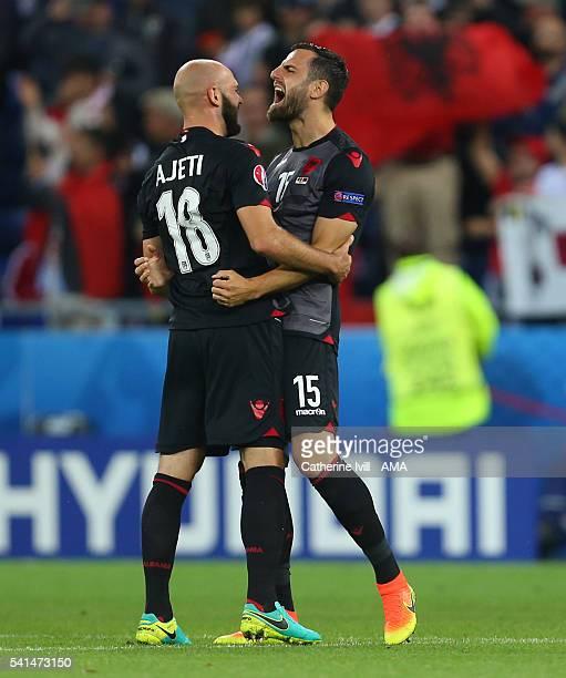 Mergim Mavraj of Albania celebrates the win with team mate Arlind Ajeti of Albania after the UEFA EURO 2016 Group A match between Romania and Albania...