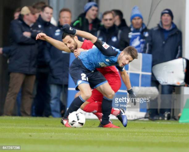 Mergim Mavraj of FC Koeln and Andrej Kramaric of Hoffenheim battle for the ball during the Bundesliga match between TSG 1899 Hoffenheim and 1 FC...
