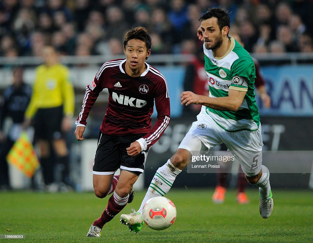 Mergim Mavraj (R) of Fuerth challenges Hiroshi Kiyotake of Nuernberg during the Bundesliga match between SpVgg Greuther Fuerth and 1. FC Nuernberg at Trolli-Arena on November 24, 2012 in Fuerth, Germany.