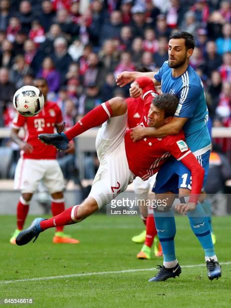 Mergim Mavraj of Hamburg challenges Thomas Mueller of Bayern Muenchen during the Bundesliga match between Bayern Muenchen and Hamburger SV at Allianz...