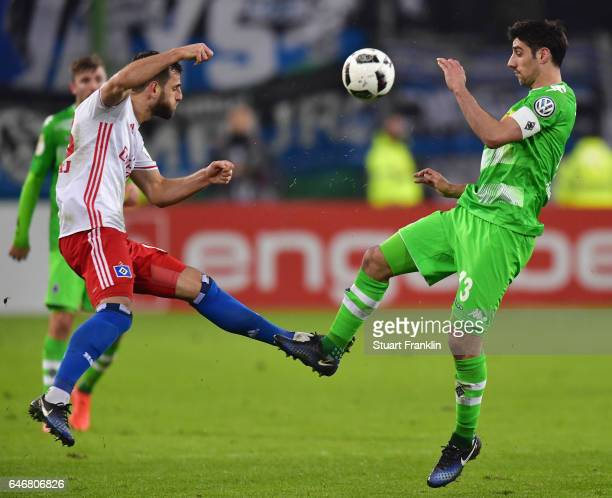 Mergim Mavraj of Hamburg is challenged by Lars Stindl of Moenchengladbach during the DFB Cup quarter final between Hamburger SV and Borussia...