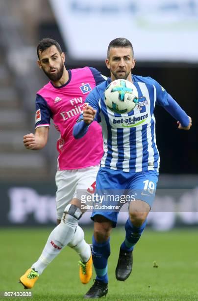 Mergim Mavraj of Hamburger SV fights for the ball with Vedad Ibisevic of Hertha BSC during the Bundesliga match between Hertha BSC and Hamburger SV...