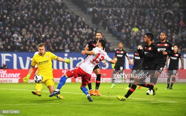 Mergim Mavraj of Hamburger SV has a shot blocked by Bernd Leno of Bayer Leverkusen during the Bundesliga match between Hamburger SV and Bayer 04...