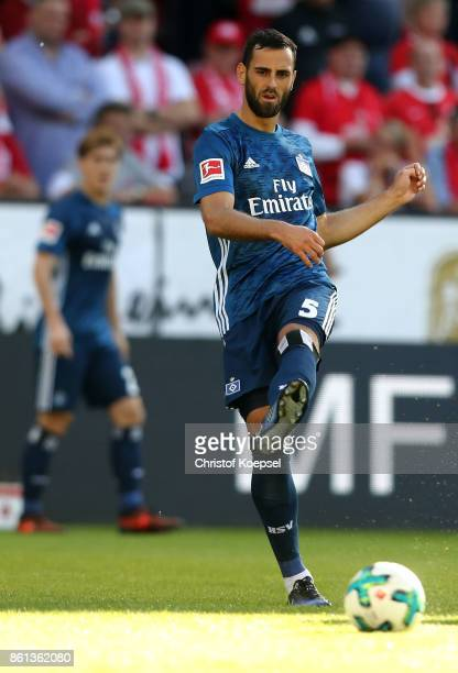 Merginm Mavraj of Hamburger SV runs with the ball during the Bundesliga match between 1 FSV Mainz 05 and Hamburger SV at Opel Arena on October 14...