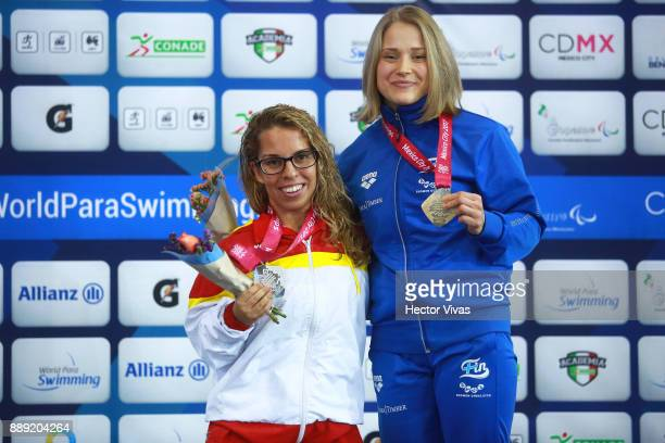 Meri Makkinen of Finland Gold Medal and Juri Marichal Silver medal of Spain celebrates in women's 200 m Freestyle SM7 during day 7 of the Para...