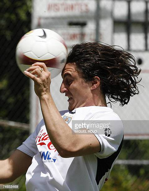 Cristian Rodriguez of the Uruguayan national football team heads the ball during a training session in Merida 27th June during the Copa America...