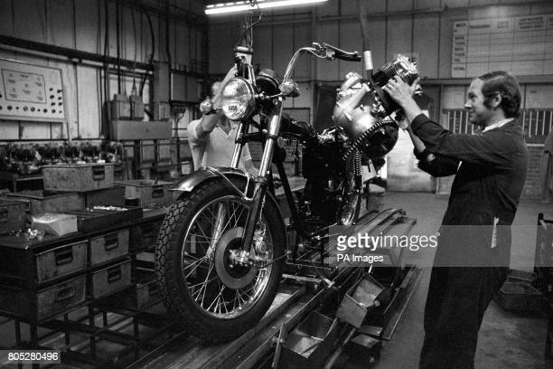 Meriden worker Barry Booth fitting the 750cc engine to a Bonneville motorcycle in the former Norton Villiers Triumph factory now being operated by a...