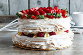 meringue cake with custard and strawberry raspberry